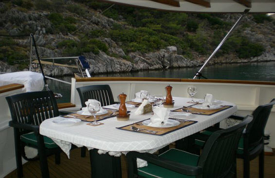 Classic Motor Yacht Watermark Dining On Deck