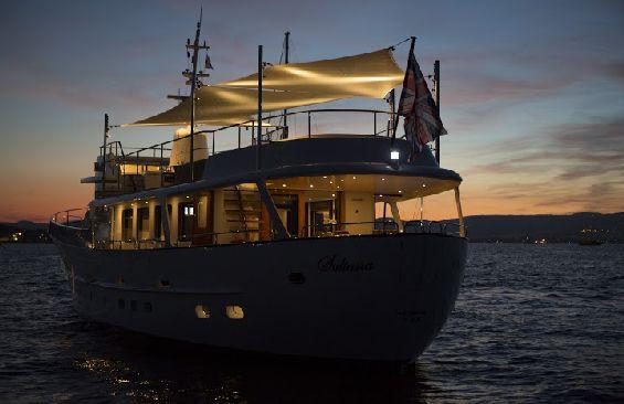 Classic Motor Yacht Sultana Anchored At Night