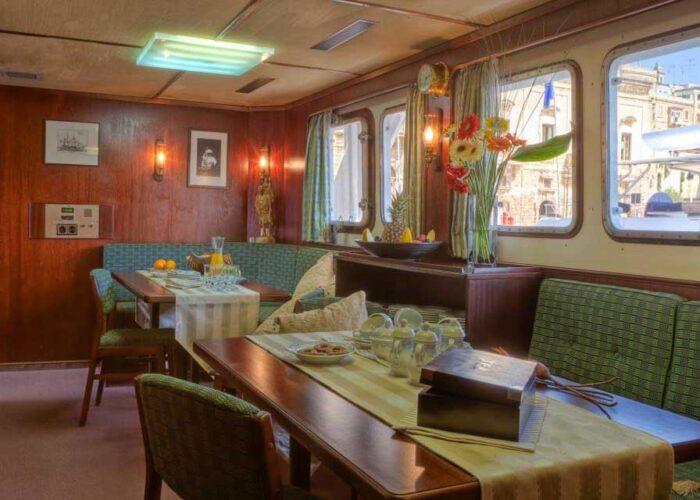 classic motor yacht sanssouci star interior saloon seating.jpg