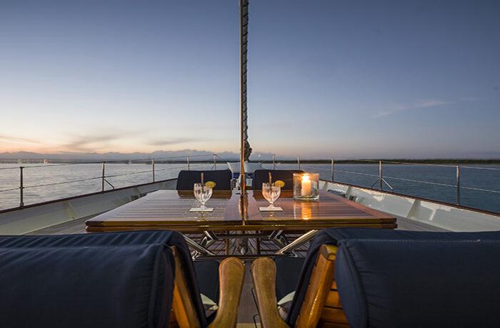 classic sailing yacht alexofloflondon alresco dining evening.jpg