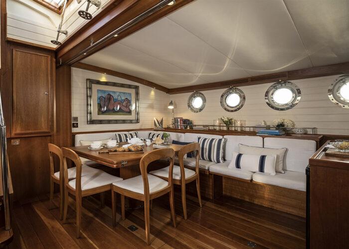 classic sailing yacht alexofloflondon saloon dining.jpg